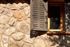 Window on a stone cabin stock images