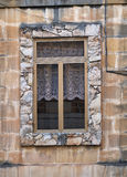 Window in a stone frame. Malta. Window in a stone frame in the wall of the residential house. Malta Royalty Free Stock Photo