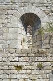 The window in the stone, medieval wall Stock Image
