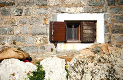 Window and stone wall Stock Photo