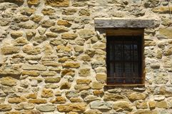 Window in a stone wall. Stone wall with window, Provence, France Royalty Free Stock Images