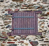 Window  in  the stone wall Stock Image