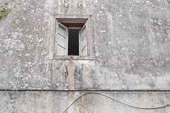 Window in stone wall Royalty Free Stock Photo