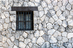 Window on stone wall Stock Photo