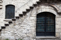 Window in a stone wall with stairs Stock Photo