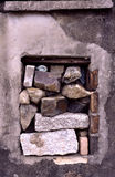 Window with stones. A broken window with big stone. a despairing way Stock Photo