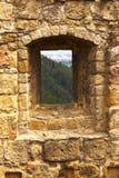 Window in a stony wall Stock Photos