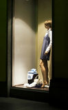 Window store at night. A store window with dressed mannequin in lit shopping mall Royalty Free Stock Photo