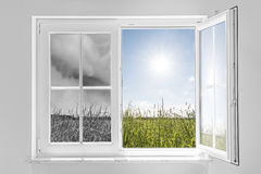 Window with storm and sun. Half open window with view to the outside half on gray storm and half on clouds in blue sky with sun Royalty Free Stock Photo