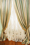 Window with striped curtians and  tulle Royalty Free Stock Photography