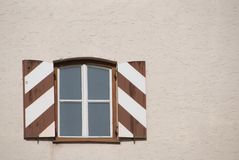 Window with striped shutters Stock Photo