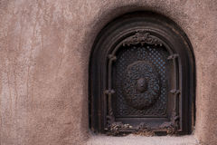 Window and Stucco. A window in the stucco of a building in Santa Fe, New Mexico Stock Photography