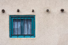 Window and Stucco. A window in the stucco of a building in Santa Fe, New Mexico royalty free stock photo