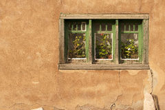 Window and Stucco. A window in the stucco of a house in Santa Fe, New Mexico Royalty Free Stock Photo