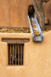Window and Stucco. A window and rain spout in Santa Fe, New Mexico Royalty Free Stock Photos