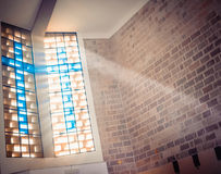 Window with sun rays in church Stock Images