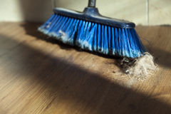 Broom, Dirt & Fur Ball on Parquet Floor Stock Photography