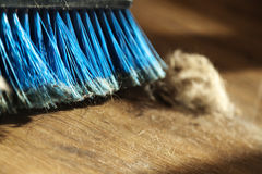 Broom, Dust & Fur Ball on Parquet Floor Royalty Free Stock Photos