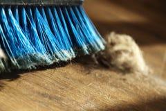Broom, Dust & Fur Ball on Parquet Floor Royalty Free Stock Photos