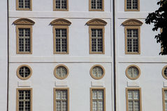 Window Symmetry. Some rows of symmetrical windows at the old castle of Gottorf in the federal state of Schleswig-Holstein in Germany Royalty Free Stock Image