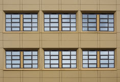 Window Symmetry. Part of a modern building facade with symmetrical windows Royalty Free Stock Image