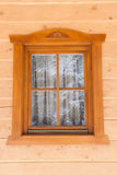 Window with thread in a wooden house. Hoarfrost on glass stock images