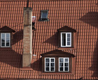 Window on tile roof. Tile roof on old building. Stock Image