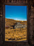 Window of Time. Looking through the window of one of the abandoned buildings at the historic ghost town of Bodie Royalty Free Stock Image