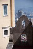 Window to the city. A stone building with two windows that overlook the beautiful city of naples Stock Image