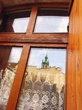 Window to the Europe city. Retro window with mirror church in Lviv Ukraine Stock Images
