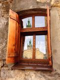 Window to the Europe city. Retro window with mirror church in Lviv Ukraine Royalty Free Stock Images