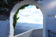 A window to heaven. Arch view green mount Monserrate Bogota Colombia clouds sky blue Stock Photo