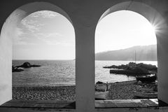 Window to the mediterranean. Watching the mediterranean sea through a window with backlighting Stock Photos