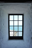 Window To The Ocean. Lighthouse Window Facing the Ocean Stock Photo