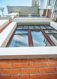 Window to red-brick building Stock Photo