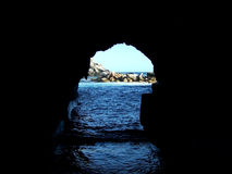 A Window to the Sea. A picturesque view from the dark royalty free stock image