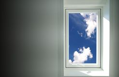 Window to the sky. Wall with window to the blue sky Stock Image