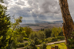 Window to the Tuscan countryside. Framed by the bark of an old tree, the heavy clouds sit over the wide expanse of Tuscan countryside on a day in early autumn royalty free stock photos