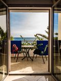 Window to vacation. Balcony with the sea view and hanging towels and swimweare stock image