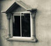A window of a traditional concrete building. Unique photo stock photos