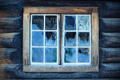 Window of a traditional Norwegian hut. With frost patterns Stock Images