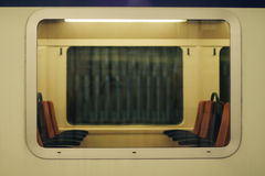 Window of a train. With view of seats inside Royalty Free Stock Photos