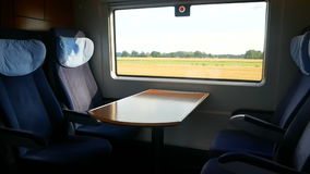 Window train speed ride. Movie on tablet during train ride window stock video footage