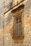 Window trellis. Building exterior with ornamented window with latticework in the historic site of Mdina on the island Malta Stock Images