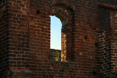 Window with a tuft of grass in a brick wall of the monastery rui. Empty window with a tuft of grass in a brick wall of the monastery ruin in Bad Doberan Stock Photos