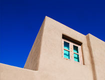 Window with Turquoise Cast in a Stucco Building Royalty Free Stock Photography