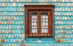 Window with turquoise wood paneling facade, Chile stock images