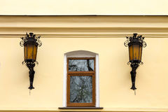 Window and two street lights. stock image