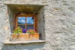 Window typical of the Swiss Alps, where the mountains are reflec Royalty Free Stock Image