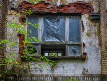 Window under plastic film in the brick wall, lost place Royalty Free Stock Photos